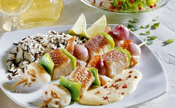 Fish and seafood kebabs with wild rice
